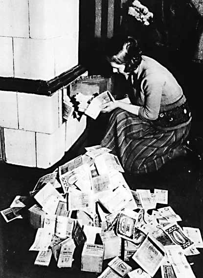 woman burning paper money for heat